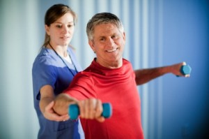 Mature Man Working With a Physical Therapist