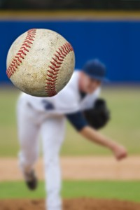bigstock-Baseball-Pitcher-Throwing-focu-48332414
